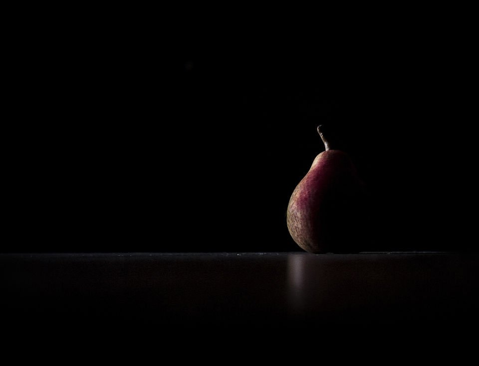 low key lighting  of a pear
